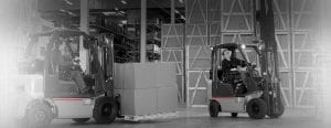 Two Forklifts transporting boxes around a warehouse